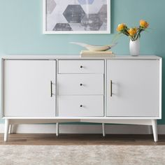 Features:  -Inspired by classic mid-century modern design.  -Stands on stylish round tapered legs.  Top Material: -Wood.  Base Material: -Wood.  Product Type: -Buffet.  Hardware Finish: -Metal.  Style