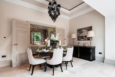 Cleeves House Cream tones and delicate use of accessories create a pretty dining area