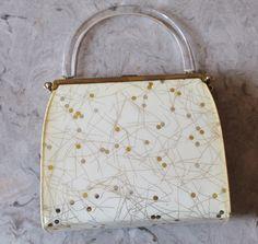 Vintage 1950's Reversible Black & Gold Metallic Atomic Space Age Mid Century Confetti Purse Bag Handbag Lucite Handle by RedHatVintage on Etsy https://www.etsy.com/listing/238681449/vintage-1950s-reversible-black-gold