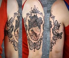 I don't really like heart tats that depict the anatomical organ as opposed to the symbol we all know.  I find it disturbing, gruesome and aesthetically displeasing.  That said, I genuinely love this,  perhaps because it's not a truly realistic rendition, and also, the singing bird inside, the oval frame made up of butterflies.  Absolutely stunning.