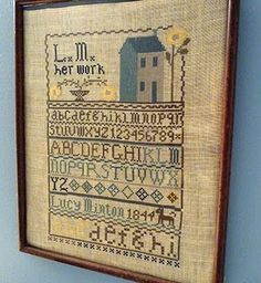 Lucy Minton sampler. Very pretty love the yellow flower and blue house