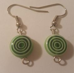Green and white circular glass beaded earrings handmade by craftybb1 on Etsy