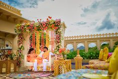 vibrant and minimalistic décor of flowers and props for haldi
