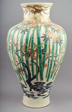 "Pottery vase. Japan. 19th century. Satsuma ware.  Decoration of ""The Three Friends"". Pine prunus and bamboo along with phoenixes. Signed. 24"" h. x 13"" d."