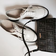 Let's get back to work.  #mclabels #fashion #ootd #inspiration #style #outfit #bag #shoulderbag #fendi #inlove #laceupshoes #white #drmartins #white #brown #stilllife #instacool #swag #classy #brand #luxury #shot #instahub #instagram #work #office