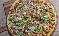 <p>This pizza is loaded with Thai-inspired ingredients and flavors like bell pepper, sprouts, baked tofu fresh herbs, and a creamy, spicy peanut sauce. It's also topped with Italian marinara sauce and creamy cashew cheese that blend together as the pizza gets crispy and warm in the oven. </p>