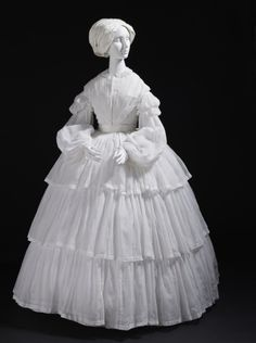 Dress, ca 1855. White muslin with cotton embroidery. Three-tiered skirt and dropped puff sleeves. Los Angeles County Museum of Art. civil war era fashion