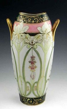 Nippon Vase..Description: Japanese Hand Painted Porcelain Vase, early 20th c., in the style of Nippon, with polychromed and gilt floral decoration, H.- 14 in., W.- 8 in., D.- 5 in.