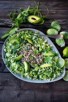 Mexican Brussel Sprout Slaw and Quinoa with avocado, chili and lime...vegan and gluten free, this makes for a fast and tasty lunch!   www.feastingathome.com