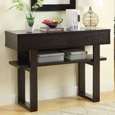 Found it at Wayfair - Console Table this would be very cool with the cubes I found as they would fit well under the ledge without dead space. They would be painted white or off white with the brass hardware.
