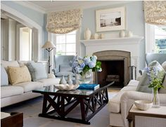 living room color schemes masonry fireplace windows with patterned valances mantel frame black wood table blue rug cream sofa of Wonderful Living Room Color Schemes to Beautify Your Home House Of Turquoise, Traditional Family Rooms, Living Room Color Schemes, Living Room Decor Light Blue Walls, Decor Room, Home Decor, Wall Decor, Family Room Design, Living Room Inspiration