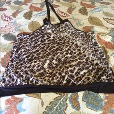 Animal print halter top in plus size Gentle used plus size animal print halter top. This item comes from smoke free home . Lane Bryant Tops Tunics