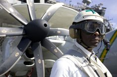 070625-N-8591H-023 USS KITTY HAWK, Coral Sea, (June 25, 2007) - Aviation Ordnanceman 1st Class Adrian Harp watches flight operations as a safety supervisor on USS Kitty Hawk (CV 63) June 25. The USS Kitty Hawk Carrier Strike Group is participating in exercise Talisman Saber in the Coral Sea near the coast of Australia. Kitty Hawk left on its summer deployment May 23 from Fleet Activities Yokosuka, Japan. U.S.Navy photograph by Mass Communication Specialist 2nd Class Jarod Hodge.