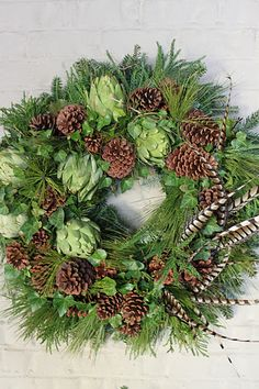All Things Farmer: Christmas. Love the use of artichokes in the wreath, other pretty Christmas ideas here as well.