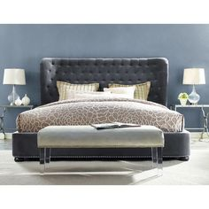 The Finley platform bed features a sculpted headboard with gentle contours on the side. The elegant and contemporary design is upholstered in a luxe grey velvet fabric. It has over 1,500 hand applied