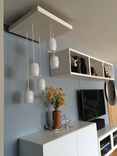 IKEA Hack of a tiered pendant lighting using the LACK side table as base.