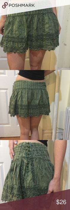 FREE PEOPLE Forest Green Crochet Mini Skirt Free People mini skirt in a gorgeous shade of green, crochet detail along the body and has button side closure. Missing one button in the middle but you just have to skip one in the middle and it's not very noticeable and doesn't effect the functionality of the skirt overall. Size 4! Price has been adjusted for missing button! Free People Skirts Mini