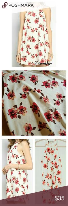 """Adorable A-line Floral Mini, LAST ONE Sweet pink flowers all over this cute flare mini, halter neckline, soft and comfortable fit.  97% Polyester,  3% Spandex.  Hand wash, line dry.  NWT.  MEASUREMENTS: Small: Bust 32"""". Waist 41"""". Length 29"""" Medium: Bust 35"""". Waist 43"""". Length 29.5"""". Large: Bust 38"""". Waist 45"""". Length 30"""". Boutique Dresses Mini"""