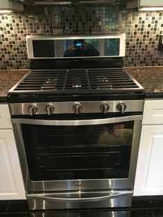 whirlpool 58 cu ft gas range with center oval burner in stainless steel silver