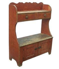 "Z75 19th century Lancaster County Pennsylvania , Bucket Bench great form with, scrolled back, With two upper dovetailed drawers over two lower paneled doors, original dry red paint . 49.5""h. 39""w. 15.5""d."