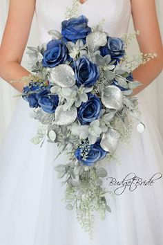 Silver Davids Bridal Wedding Flowers glitter calla lilies blue roses hydrangea horizon royal blue grey metallic cascading bouquet bride artificial fak… - All About Wedding Flower Guide, Winter Wedding Flowers, Diy Wedding Bouquet, Cascading Bridal Bouquets, Purple Bouquets, Wedding Hijab, Flower Bouquets, Wedding Ideas, Wedding Ceremony