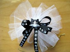 Cat gift bow Animal bow Paw print ribbon Cat face bow by jandavis2, $3.75