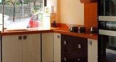 Modern restaurant with orange granite worktops