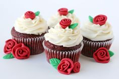 Red velvet cupcakes with cream cheese icing and fondant roses ^~^ this reminds me if Belle from beauty and the beast