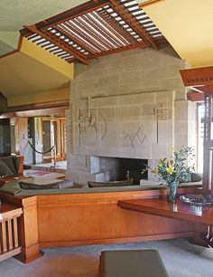 The cast concrete fireplace incorporates geometry from Hollyhock House's layout and ornament generated by its namesake, the favorite plant of owner Aline Barnsdall.