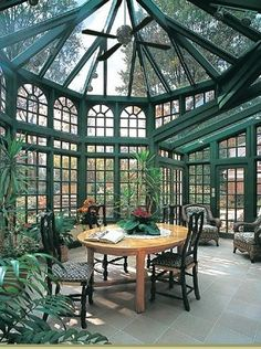 Lol imagine this in my backyard!  multi-faceted greenhouse and conservatory.