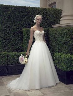 This gorgeous Casablanca 2191 wedding dress is strapless with a ball gown wedding dress silhouette and an elegant chapel train.This elegant Casablanca gown is perfect for any wedding season or any type of wedding venue. #weddingdress