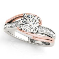 14K Rose and White Gold Engagement Ring. Holds a brilliant cut center diamond. Matthew Erickson Jewelers.