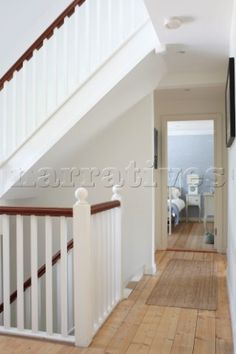 White painted banisters and wooden hallway to bedroom in Bembridge farmhouse Isle of Wight England Painted Banister, Banisters, Wooden Staircases, Stairways, Isle Of Wight England, Staircase Runner, Interior Photography, White Paints, Farmhouse