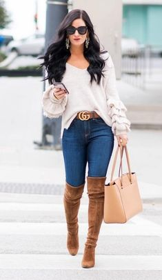 Here is a look you'll see on everyone from Bella Hadid to Kim Kardashian. Go full-on glamorous with over-the-knee suede boots over skintight denim jeans and an oversized sweater.