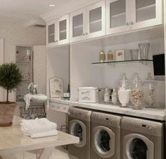 Apothecary Jars to hold laundry soap and other things. Makes it look pretty. Laundry room.....