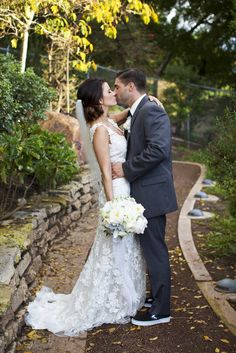 Wedding kiss outdoors.