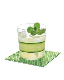 """Cucumber Mint Gimlet -- Serve the ultimate country-club libation: gimlets. Swap out vodka and Rose's lime juice for cucumber gin, fresh lime, and simple syrup tinged with mint, and then serve with tea sandwiches. Polka dot napkins in a shade that matches the drink pack a coordinating graphic punch. """"Pearls"""" paper napkin, $5 for 20, casparionline.com."""