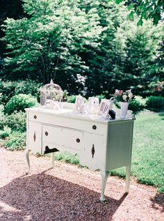 Dresser. Floral Design: The Green Flamingo. Photography: Nikki Santerre Photography - nikkisanterre.com