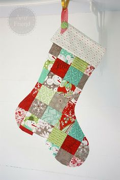 Isn't this just perfect for gals that love scrappy quilts! A scrappy patchwork stocking.. Pattern is available from HERE