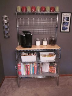 Bakers rack turned coffee bar---- mine will be cooler than this. :)