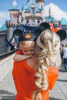 Baby takes on Disneyland