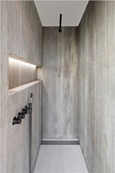 Walk-in shower in Oak Grey Woodstructure stone. Design by anja Vissers, stone by…
