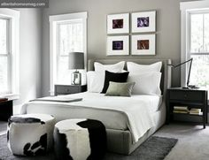 A favorite bedroom:  grey + white w/black + white hide stools; area rug; windows flanking bed