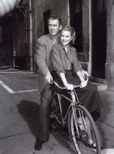 """I admire anyone who looks that good on a bicycle! 1954 --- Actress Grace Kelly and actor James Stewart on the set of """"Rear Window"""""""