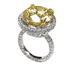 Yellow diamond engagement ring. Sazingg.
