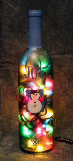 Small Wine Bottle hand painted with Snowman and other Christmas stuff with multi colored lights