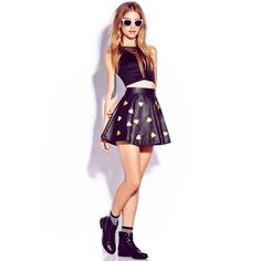 Forever 21 Faux Leather Gold Heart Skirt NWOT A faux leather skater skirt featuring an allover metallic heart pattern. Banded waist. Exposed back zipper. Fully lined. Medium weight. Shell: Coating: 100% polyurethane; Backing: 100% viscose; Lining: 100% polyester. As seen on Ariana Grande. NO TRADES! NWOT. No rips/tears/stains. Forever 21 Skirts Mini