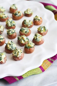 Mini Spinach and Artichoke Stuffed Potatoes…Fun and light appetizers for any time of the year! 39 calories and 1 Weight Watchers Smart Points   cookincanuck.com #recipe