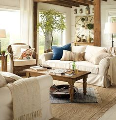 cute living room, i like the double layer of rugs