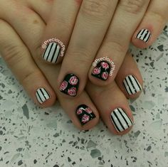 Black and white nails with stripes and roses. Valentine's day nails
